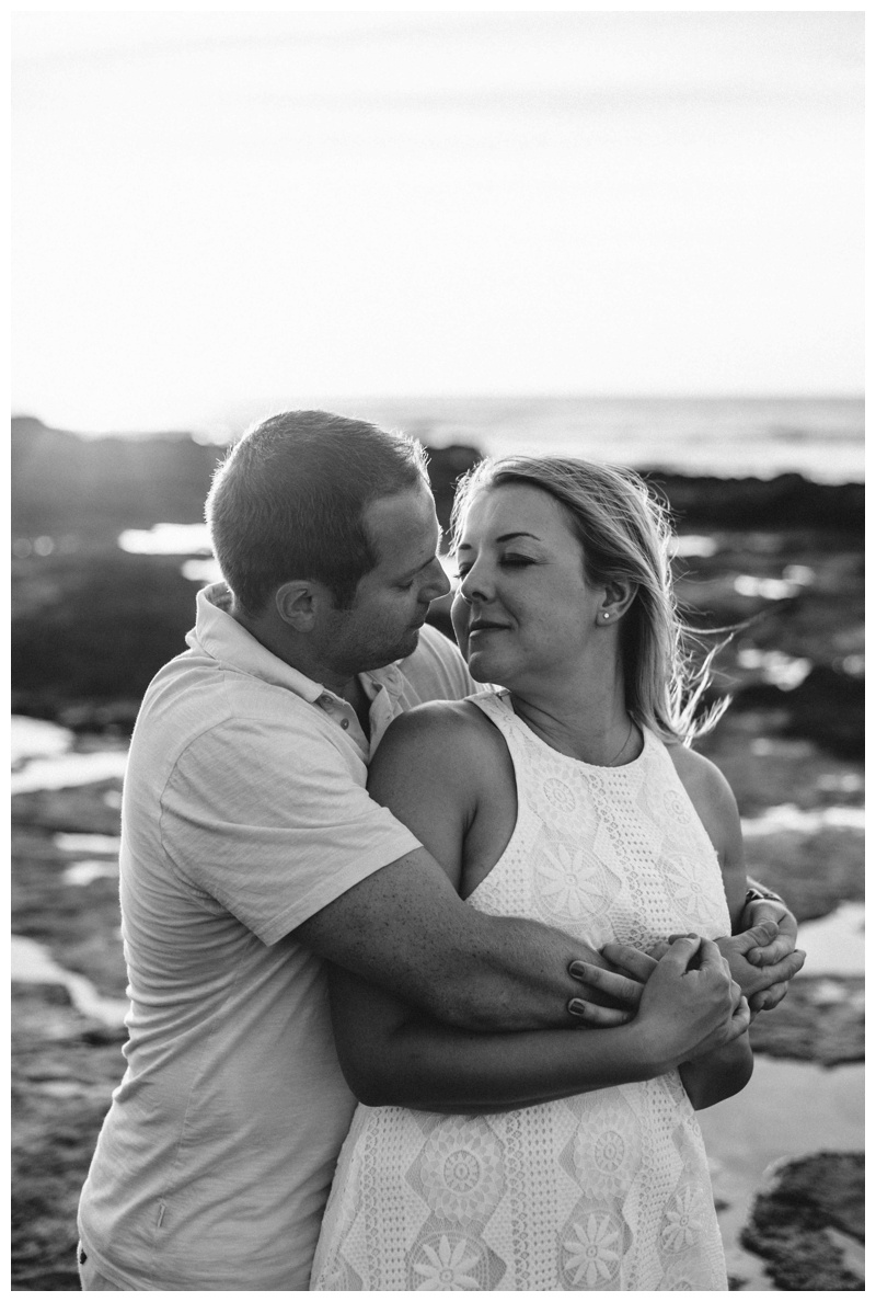 Black and white photo of couple kissing during a beautiful sunset in Costa Rica. Photographed by Kristen M. Brown, Samba to the Sea Photography.