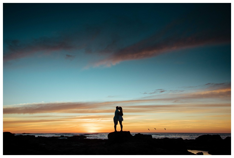 Couple kissing during a beautiful sunset in Costa Rica. Photographed by Kristen M. Brown, Samba to the Sea Photography.