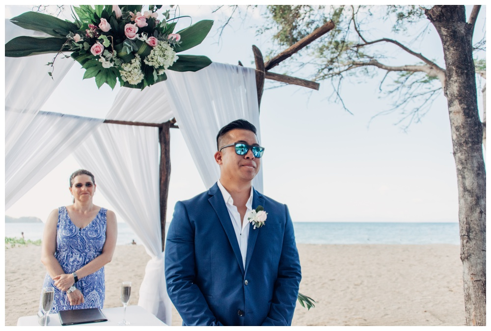 Groom tearing up as he sees his bride walk down the aisle. Wedding in Guanacaste Costa Rica. Photographed by Kristen M. Brown, Samba to the Sea Photography.