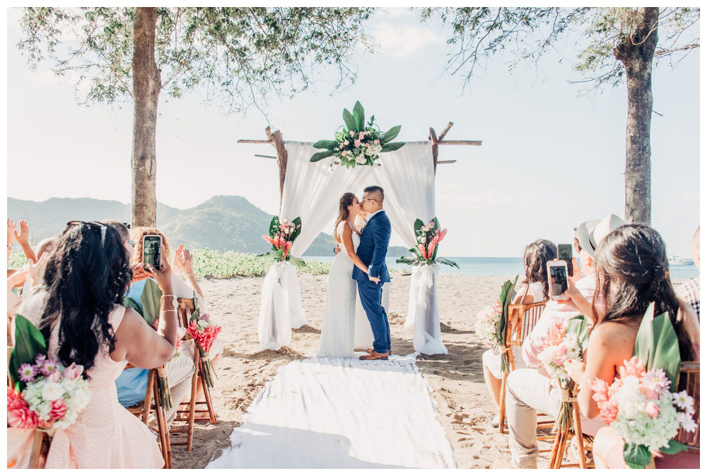 First kiss on the beach in Costa Rica. Wedding in Guanacaste Costa Rica. Photographed by Kristen M. Brown, Samba to the Sea Photography.