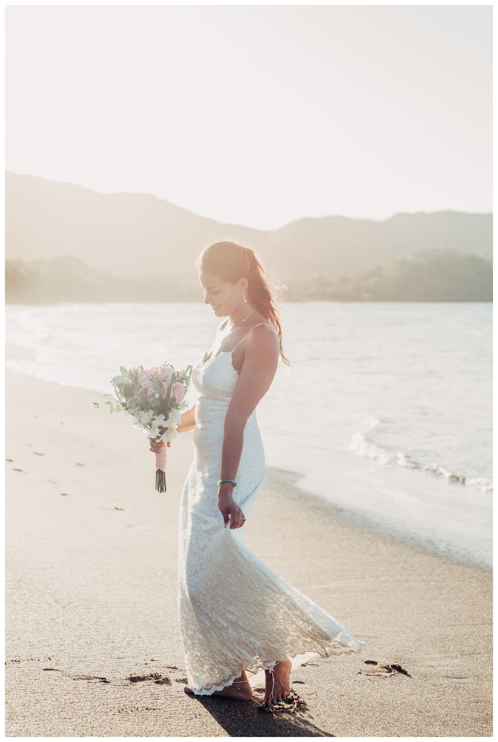 Bride dancing and twirling her dress on the beach in Costa Rica. Wedding in Guanacaste Costa Rica. Photographed by Kristen M. Brown, Samba to the Sea Photography.