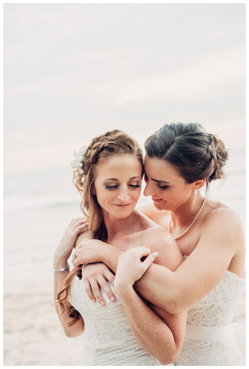 Brides embracing after their wedding in Tamarindo Costa Rica. Photographed by Kristen M. Brown, Samba to the Sea Photography.