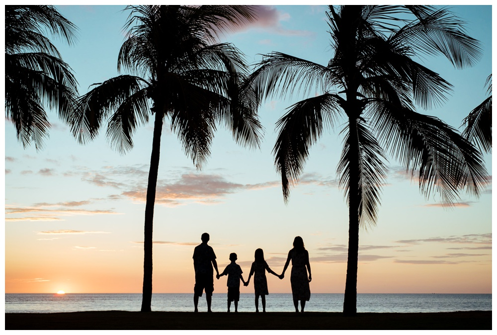 Family standing under palm trees during sunset in Playa Flamingo Costa Rica. Photographed by Kristen M. Brown, Samba to the Sea Photography.