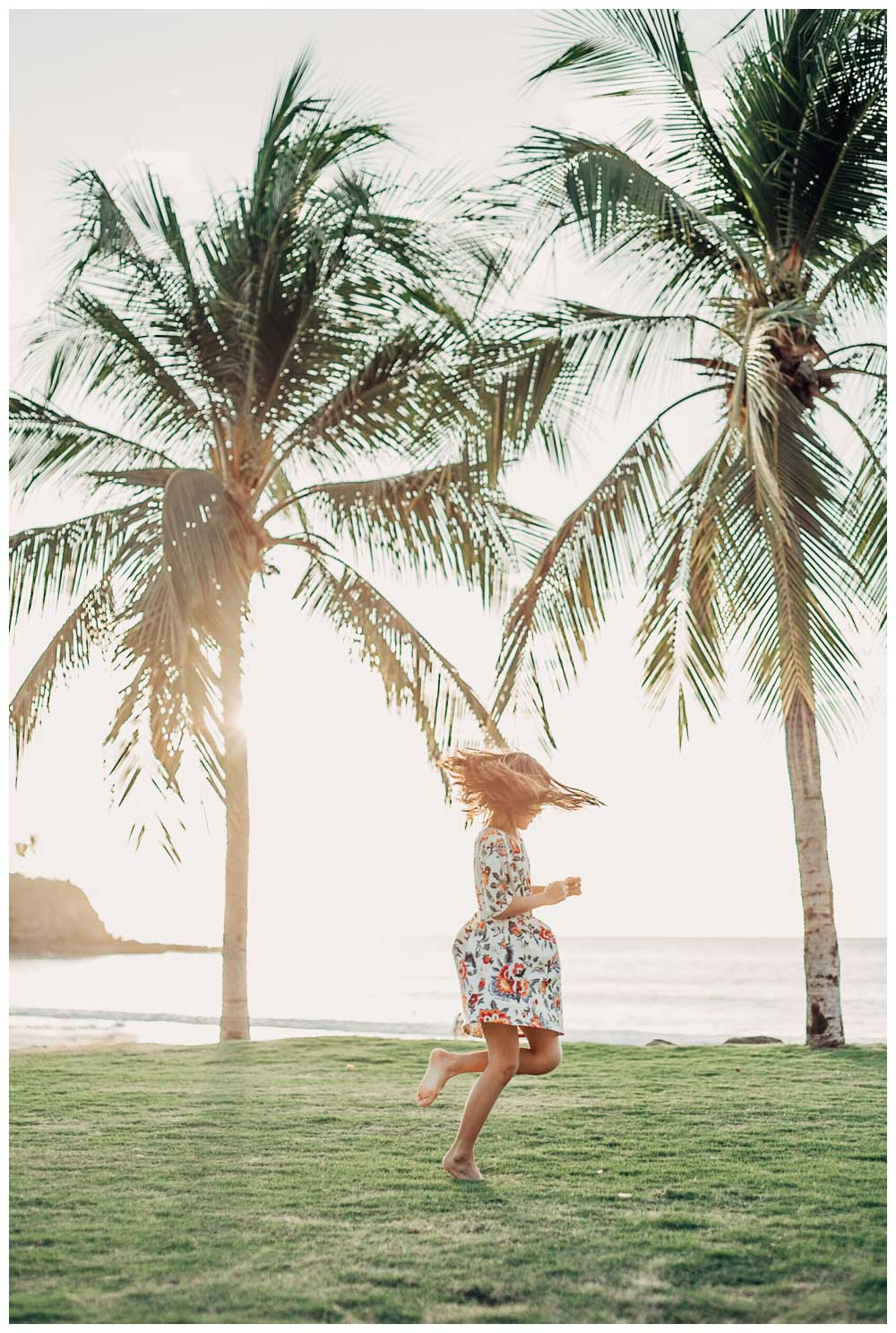 Girl dancing under palm trees in Playa Flamingo Costa Rica. Photographed by Kristen M. Brown, Samba to the Sea Photography.