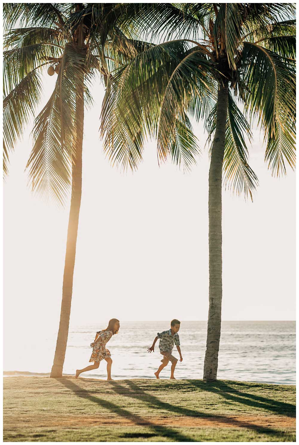 Kids running under palm trees in Playa Flamingo Costa Rica. Photographed by Kristen M. Brown, Samba to the Sea Photography.
