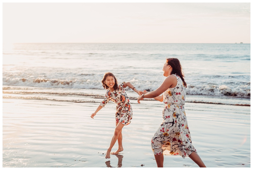 Mother and daughter playing on the beach during family photos in Playa Flamingo Costa Rica. Photographed by Kristen M. Brown, Samba to the Sea Photography.