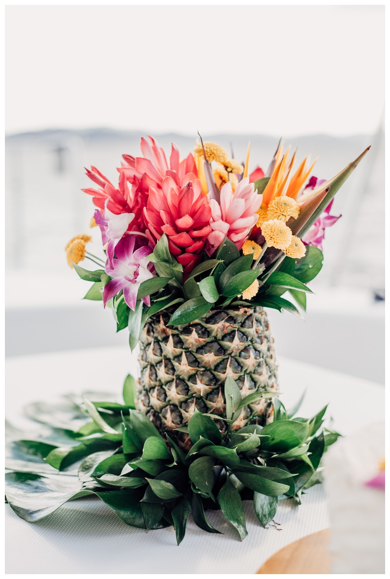 Tropical pineapple centerpiece at magical sailboat elopement in Costa Rica. Photographed by Kristen M. Brown, Samba to the Sea Photography.