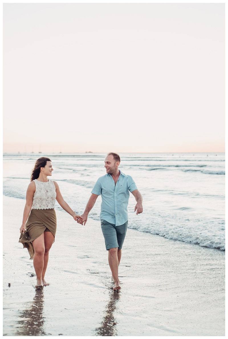 Couple walking on the beach. Romantic sunset beach proposal in Tamarindo Costa Rica. Photographed by Kristen M. Brown, Samba to the Sea Photography.