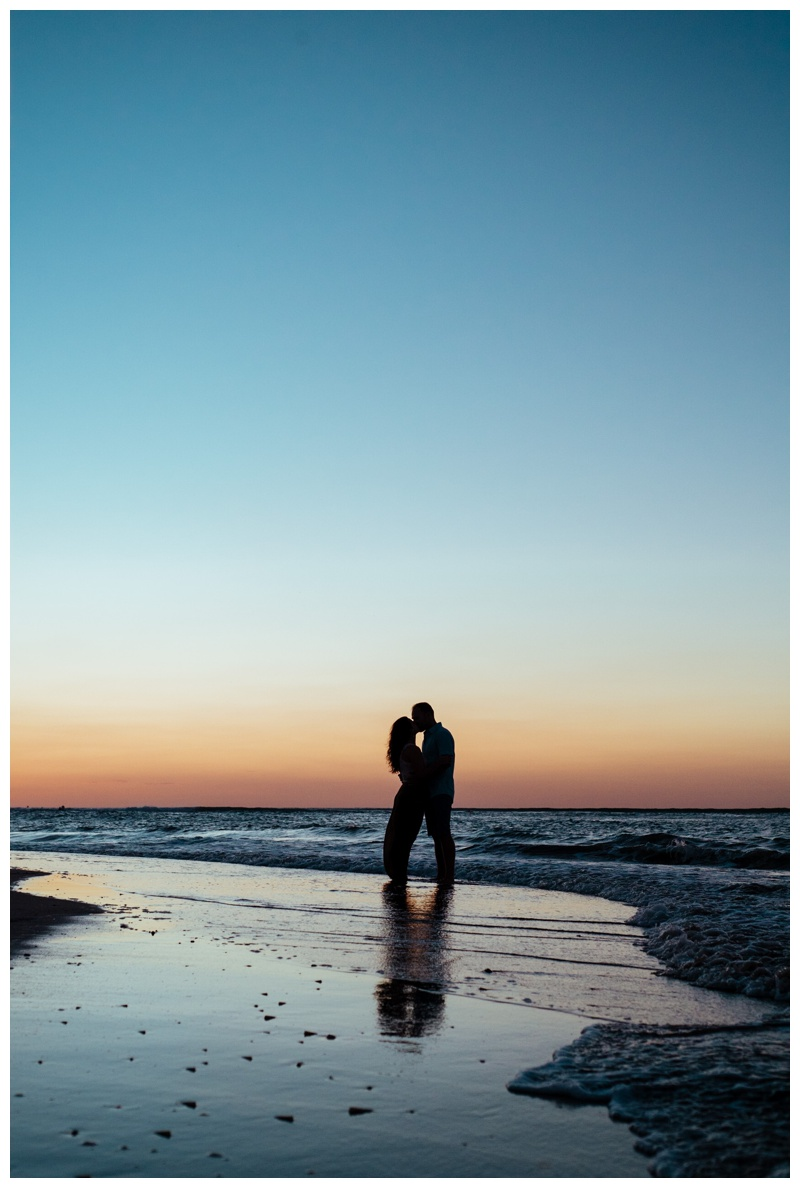 Couple kissing at sunset. Romantic sunset beach proposal in Tamarindo Costa Rica. Photographed by Kristen M. Brown, Samba to the Sea Photography.