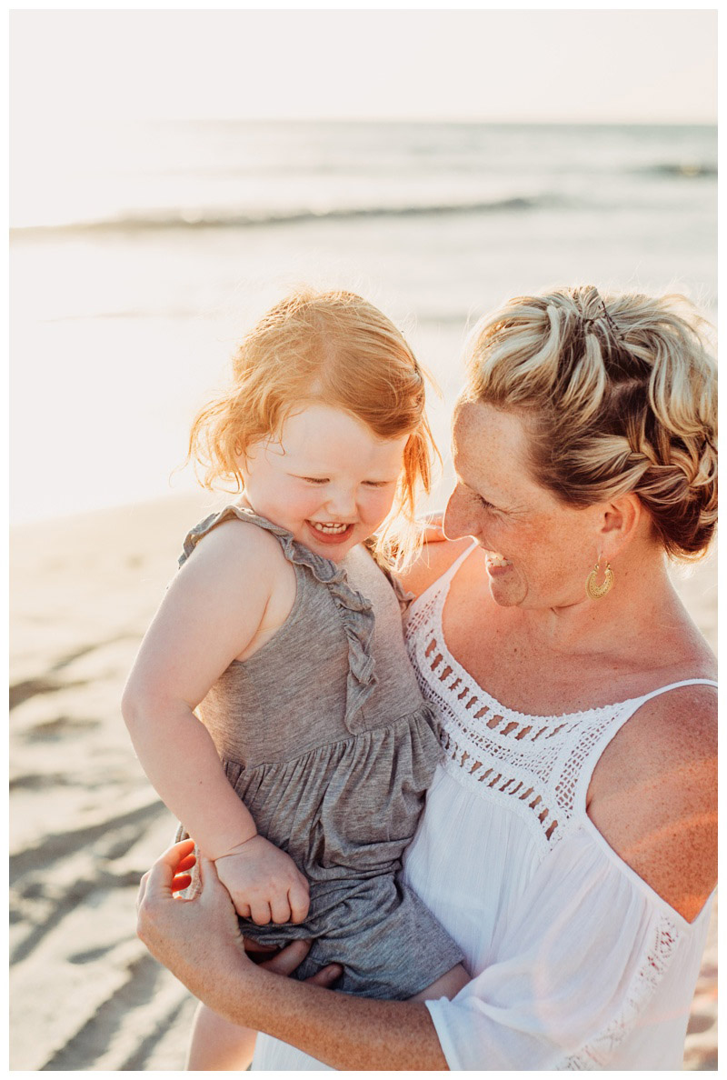 Mother playing on the beach with her daughter in Nosara Costa Rica. Photographed by Kristen M. Brown, Samba to the Sea Photography.