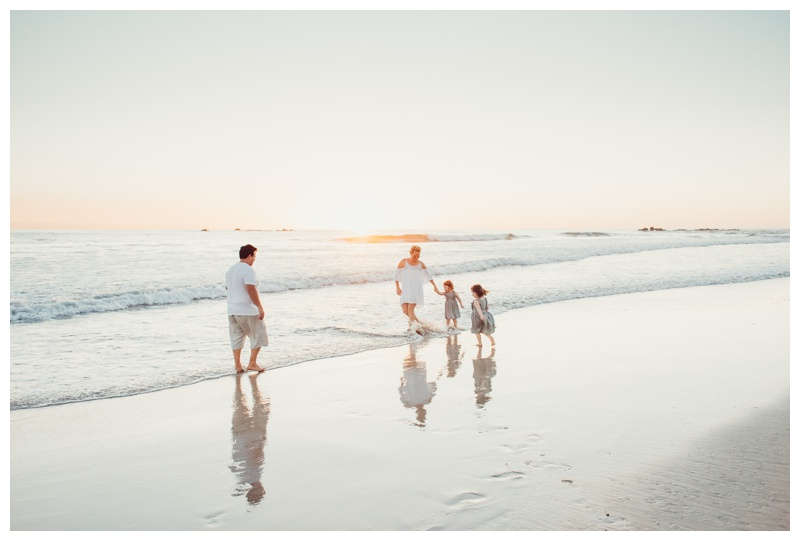 Family playing on the beach in Nosara Costa Rica. Photographed by Kristen M. Brown, Samba to the Sea Photography.