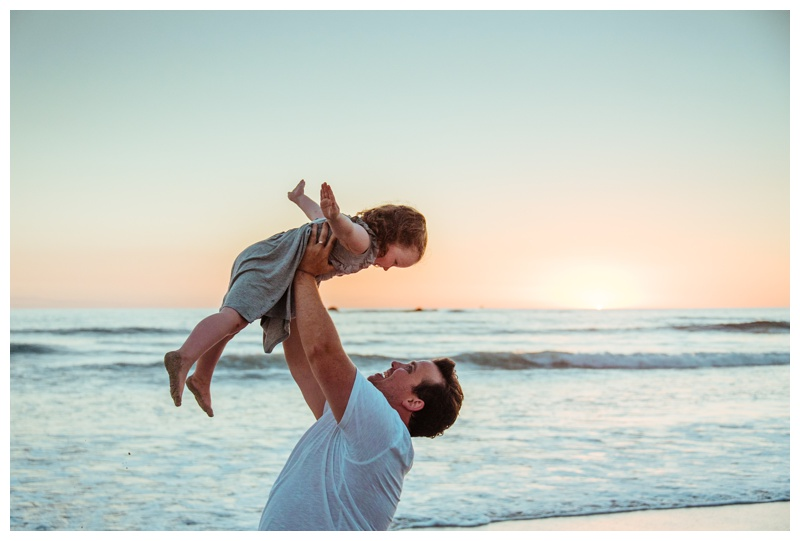 Father playing with his daughter on the beach during sunset in Nosara Costa Rica. Photographed by Kristen M. Brown, Samba to the Sea Photography.