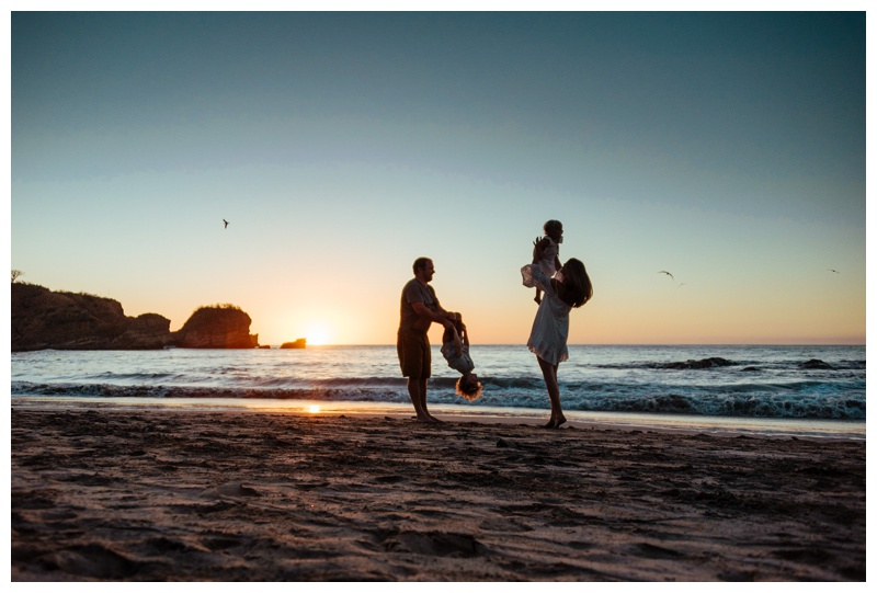 Family playing on the beach during sunset in Nosara Costa Rica. Photographed by Kristen M. Brown, Samba to the Sea Photography.