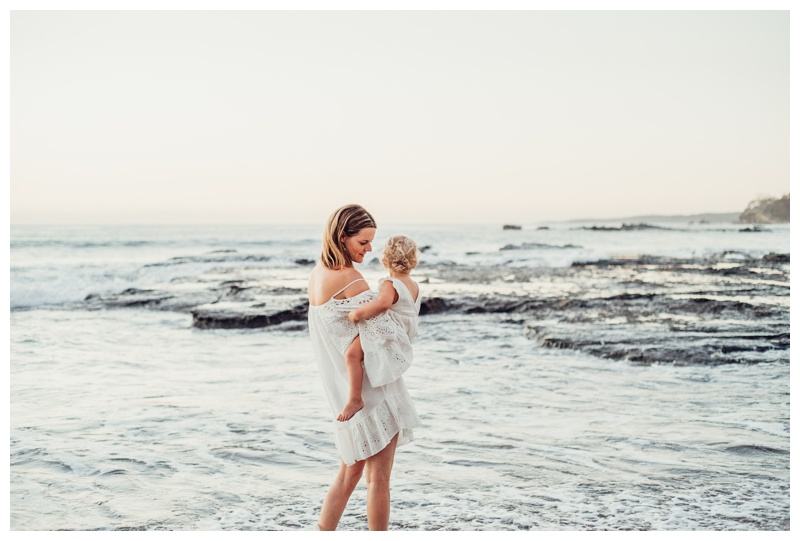 Mother with her little girl on the beach in Nosara Costa Rica. Photographed by Kristen M. Brown, Samba to the Sea Photography.