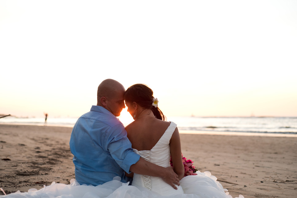 Bride and groom on the beach after their elopement in Tamarindo. Photographed by Kristen M. Brown, Samba to the Sea Photography.