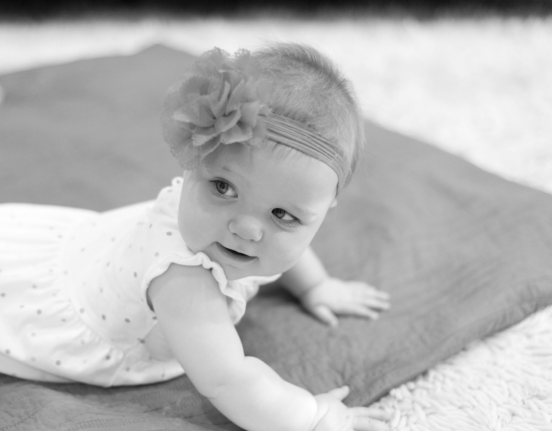 Black and white photo of adorable baby. Photographed by Savannah Family Photographer Kristen M. Brown, Samba to the Sea Photography.