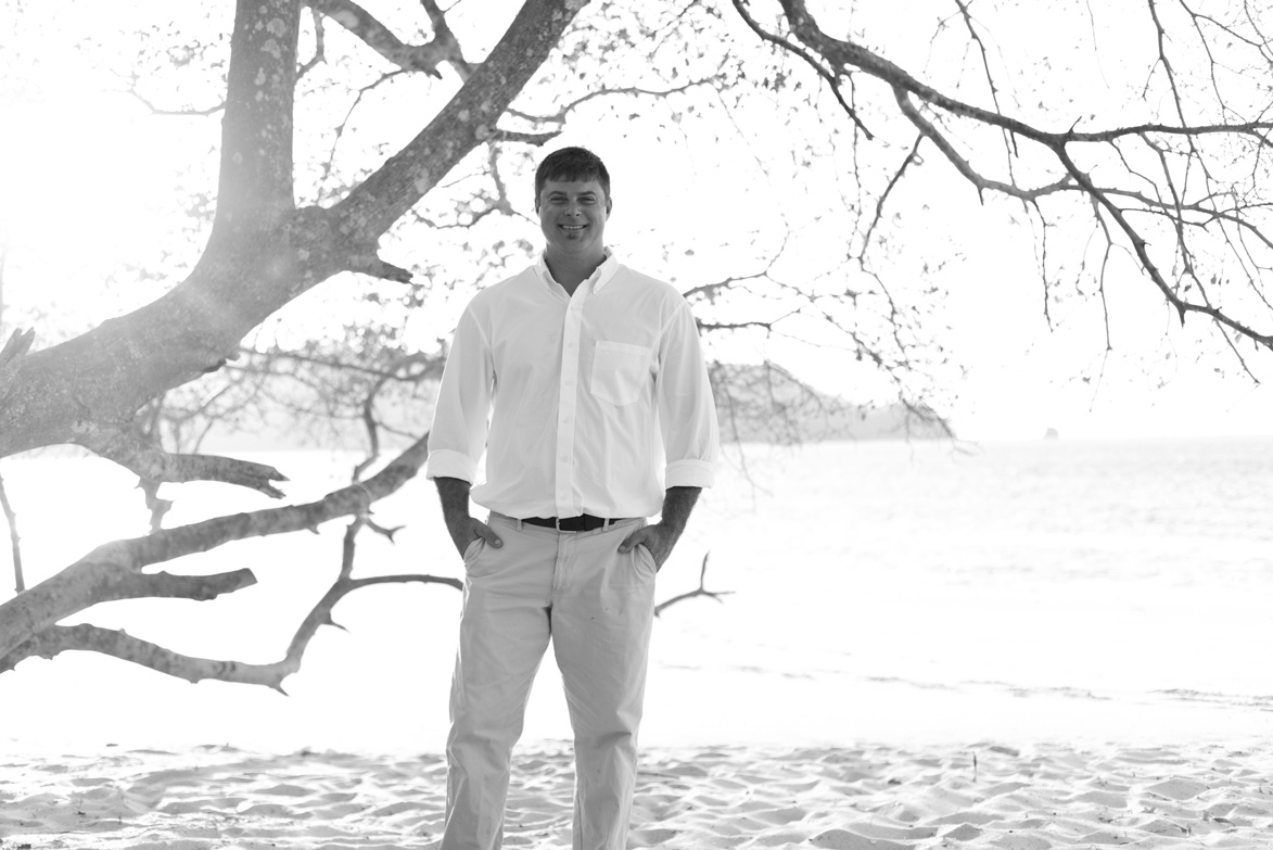 Groom portrait on the beach at Playa Conchal, Costa Rica. Photographed by Kristen M. Brown, Samba to the Sea Photography.