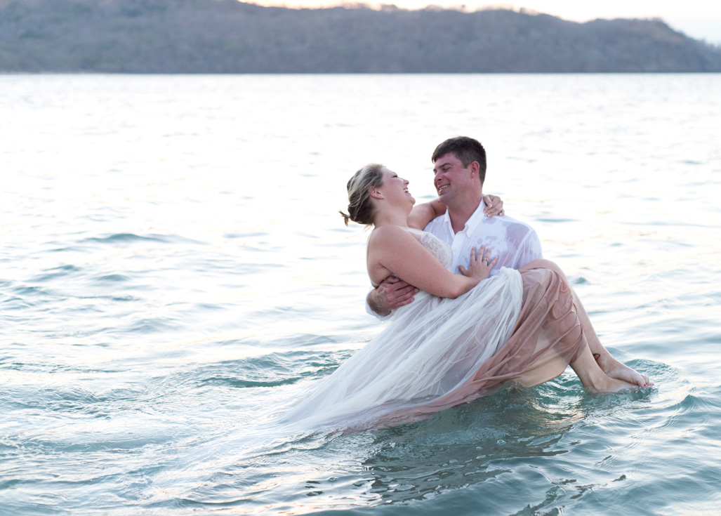 Trash the dress photos in Playa Conchal, Costa Rica. Photographed by Kristen M. Brown, Samba to the Sea Photography. BHLDN Penelope Dress