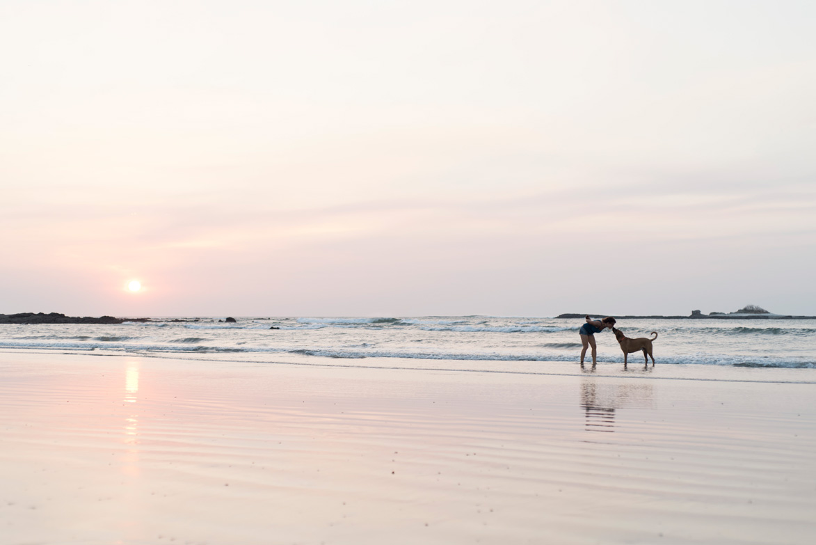 Ridgeback giving his owner a kiss during sunset in Tamarindo, Costa Rica.