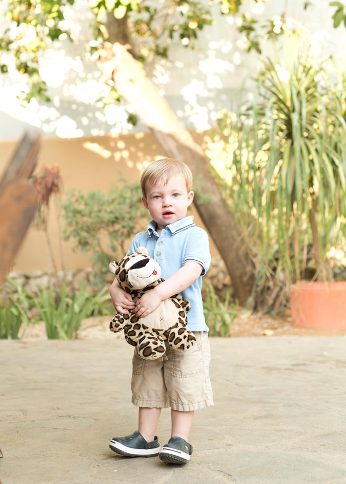 Toddler holding his stuffed animal at Casa Redonda in Tamarindo, Costa Rica. Photographed by Kristen M. Brown, Samba to the Sea Photography.
