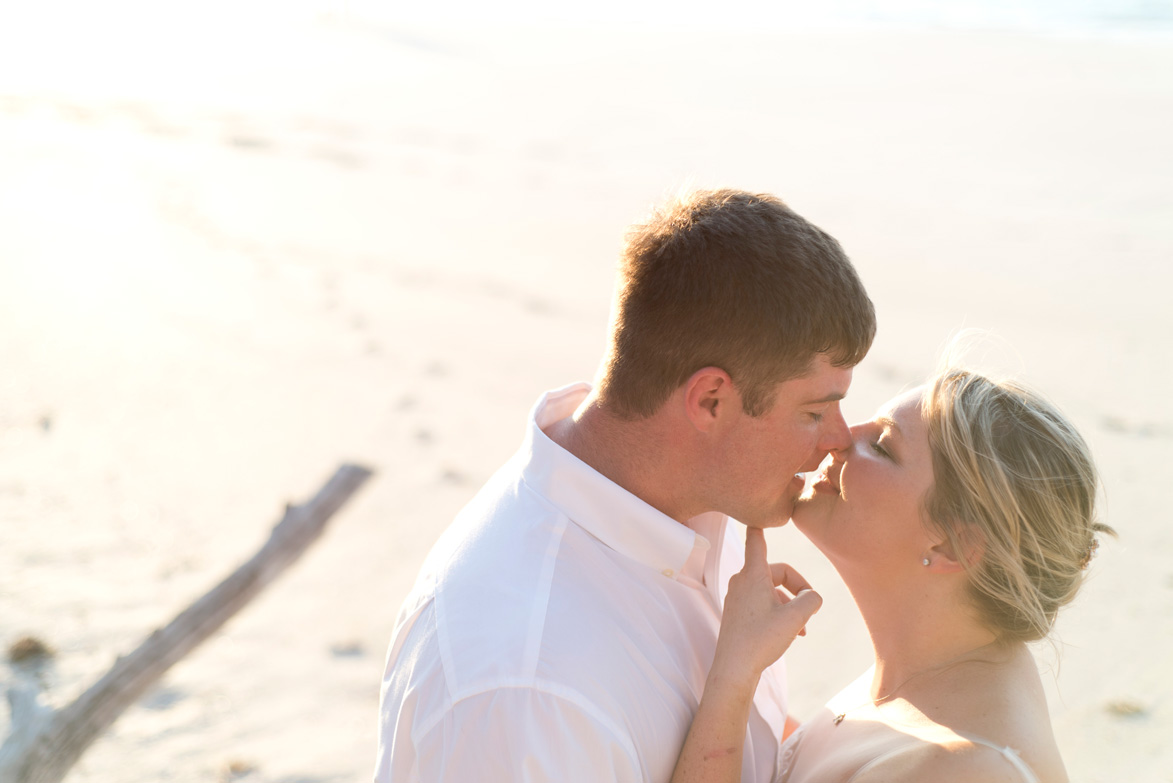 Romantic kiss on the beach at Playa Conchal, Costa Rica. Photographed by Kristen M. Brown, Samba to the Sea Photography.