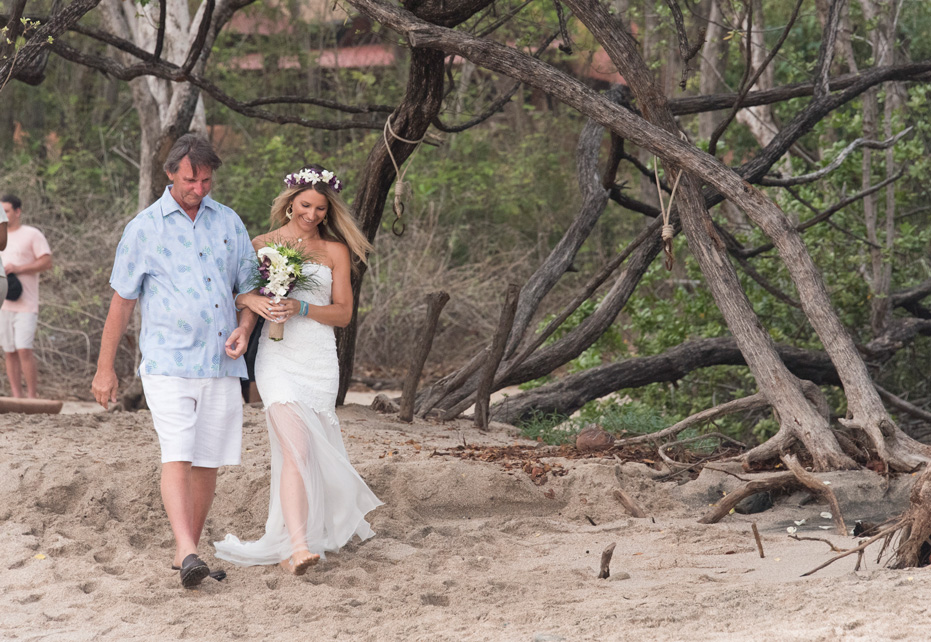 Father of the bride and bride walking down the aisle at Playa Langosta, Costa Rica. Photographed by Kristen M. Brown, Samba to the Sea Photography.