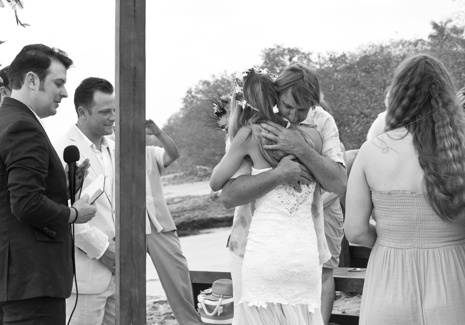 Father of bride hugging his daughter as he gives her away at wedding in Playa Langosta, Costa Rica. Photographed by Kristen M. Brown, Samba to the Sea Photography.