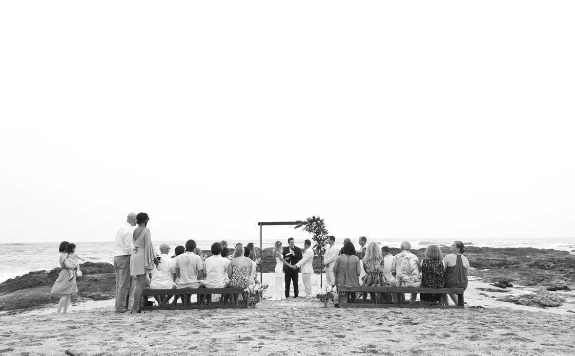 Black and white photo of beach wedding on Playa Langosta, Costa Rica.