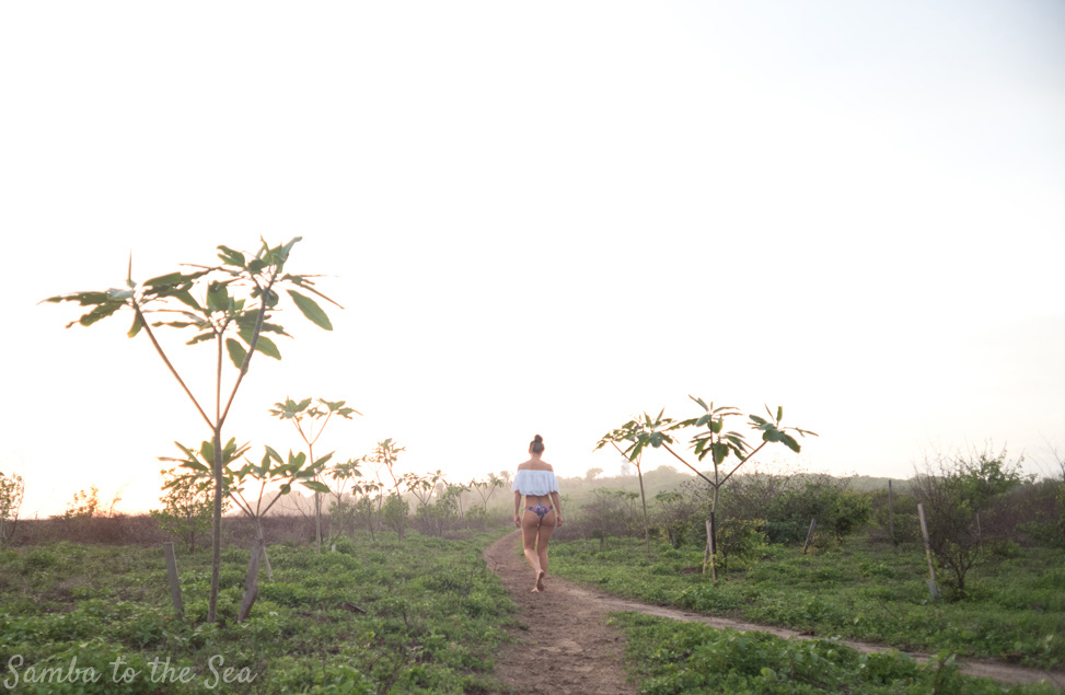 Kim walking the beach path at Playa Guiones in Nosara, Costa Rica. Photographed by Kristen M. Brown, Samba to the Sea Photography.