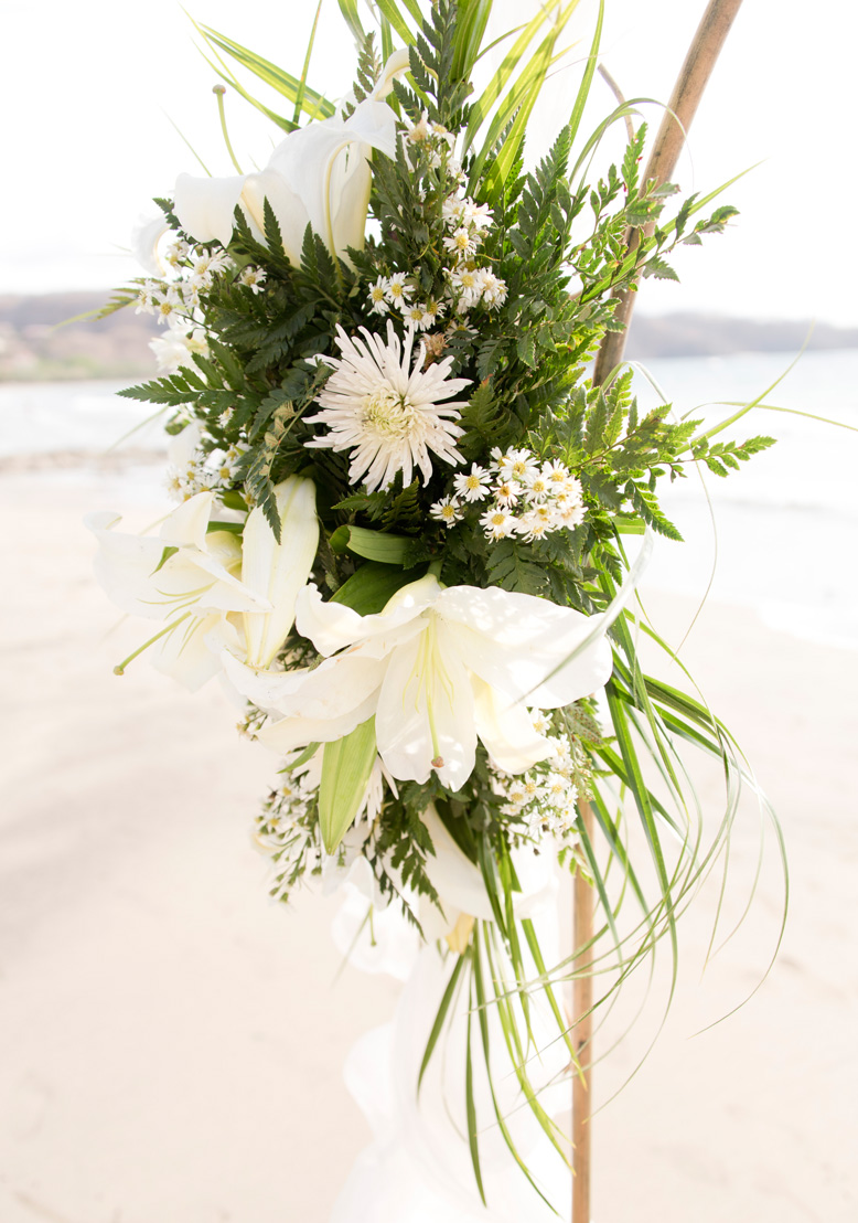 Wedding flowers on altar at Playa Hermosa, Costa Rica. Photographed by Kristen M. Brown, Samba to the Sea Photography.