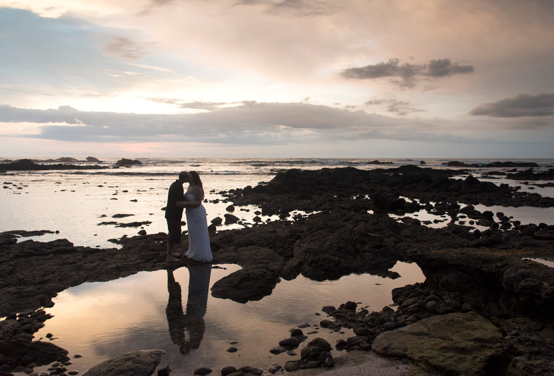 Couple kissing at sunset during their elopement on Playa Langosta, Costa Rica. Photogaphed by Kristen M. Brown, Samba to the Sea Photography.