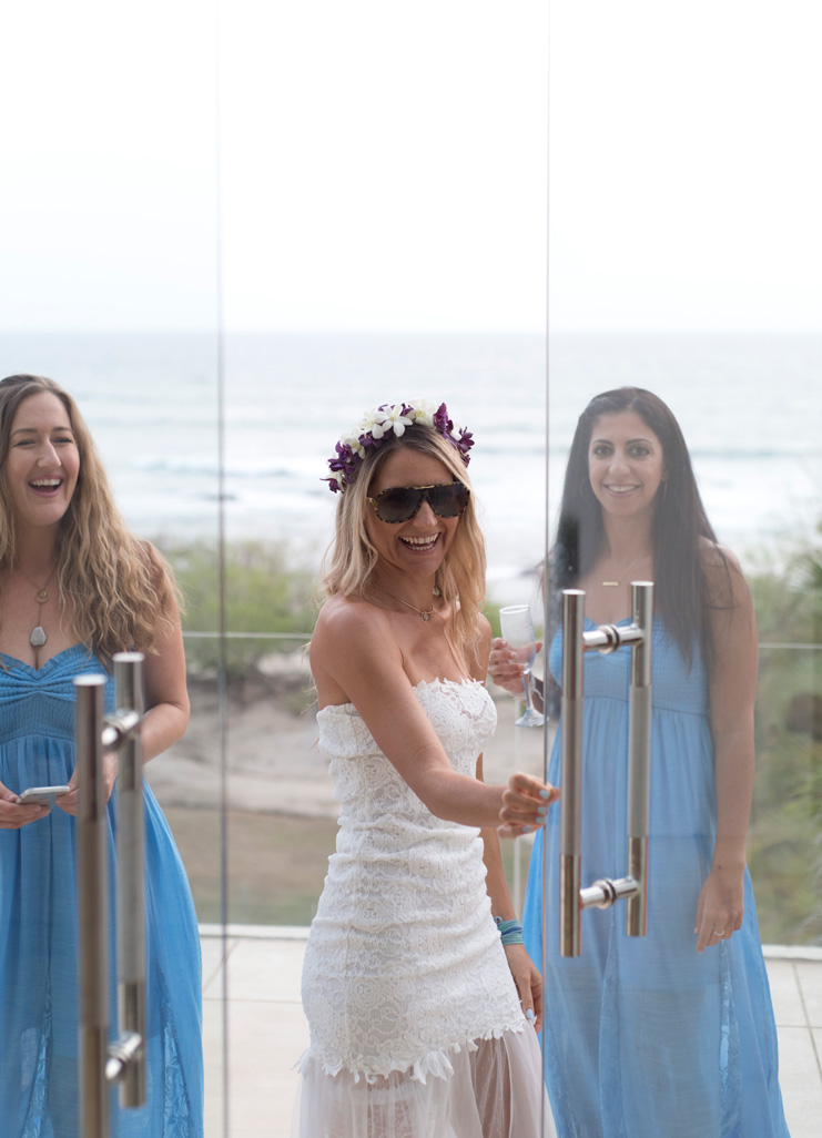 Bride with her bridesmaids at Casa Cristal in Playa Langosta, Costa Rica.