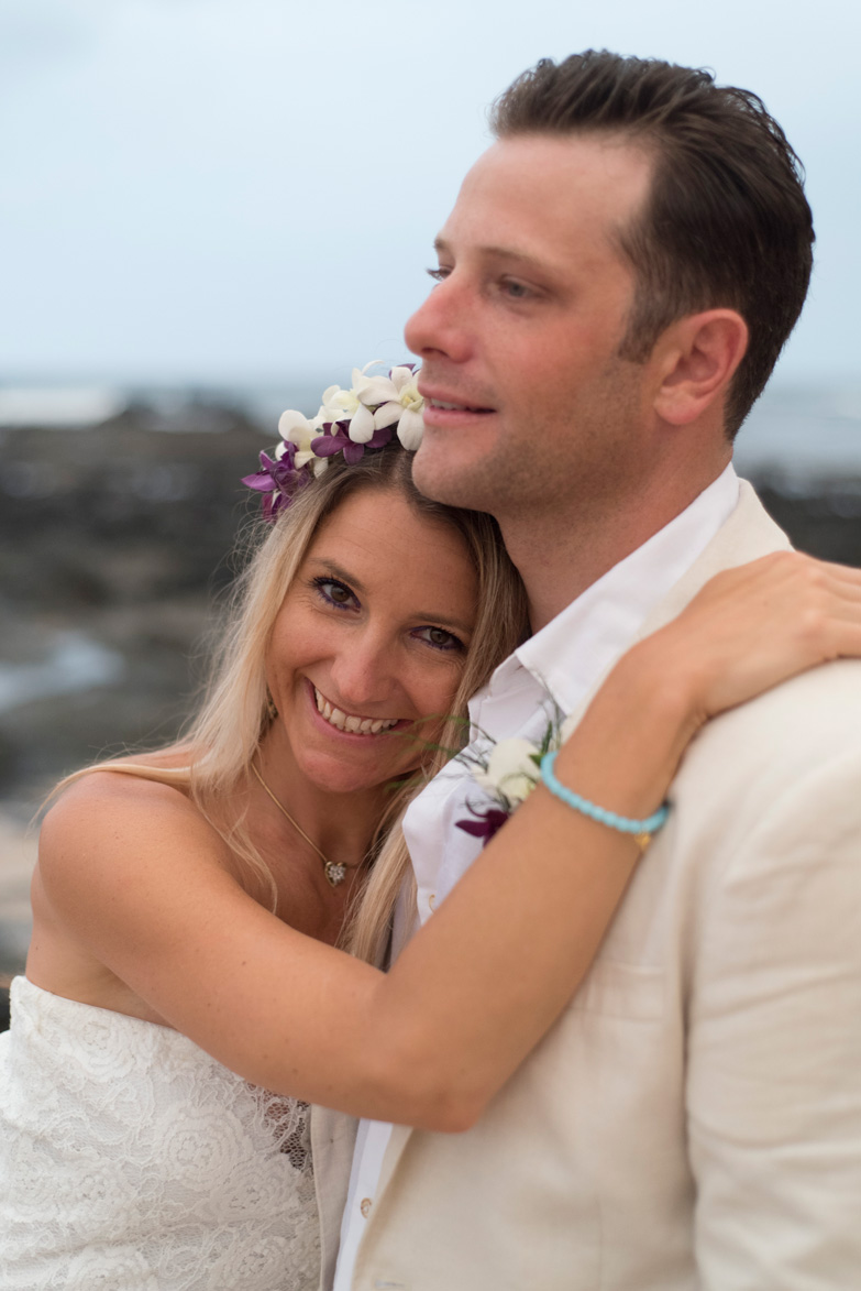 Bride smiling on the beach in Playa Langosta, Costa Rica. Photographed by Kristen M. Brown, Samba to the Sea Photography.