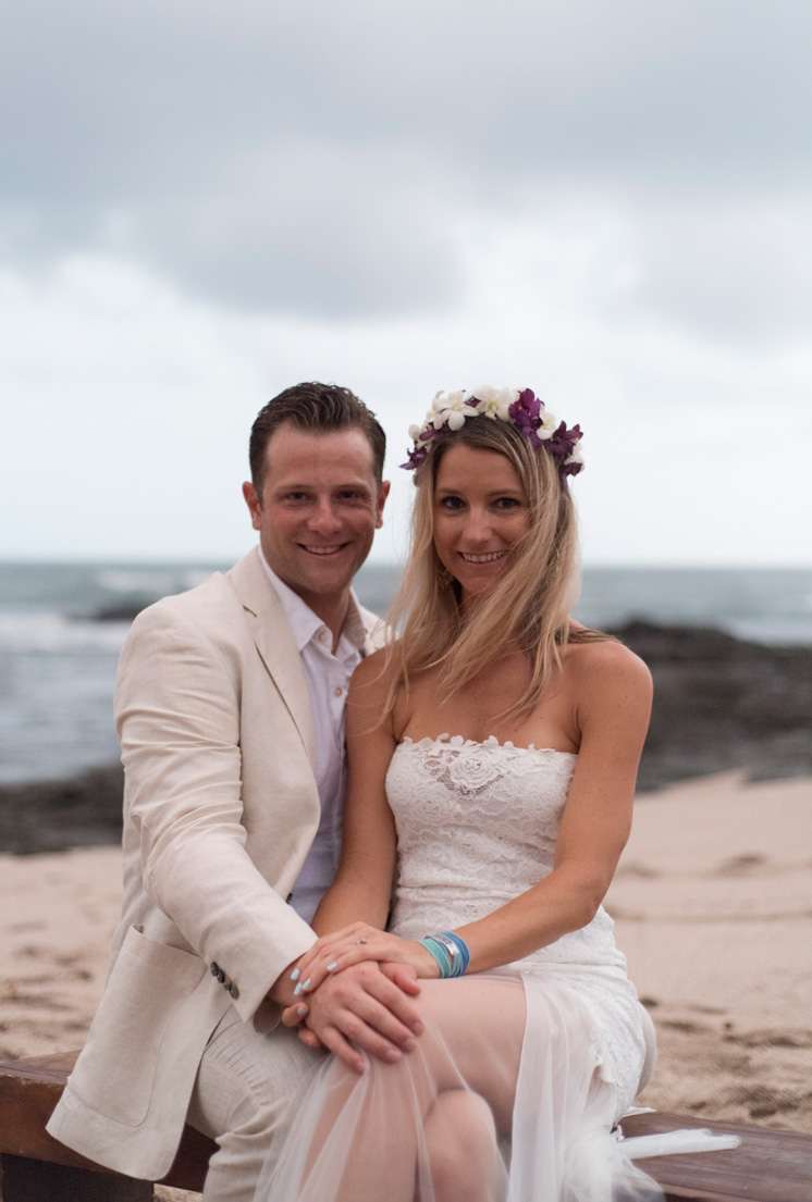 Bride and groom smiling after beach wedding in Playa Langosta, Costa Rica. Photographed by Kristen M. Brown, Samba to the Sea Photography.
