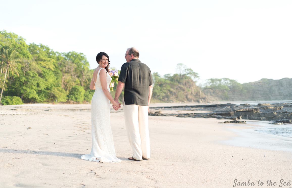 Bride and groom on the beach in Nosara, Costa Rica. Photographed by Kristen M. Brown, Samba to the Sea Photography.