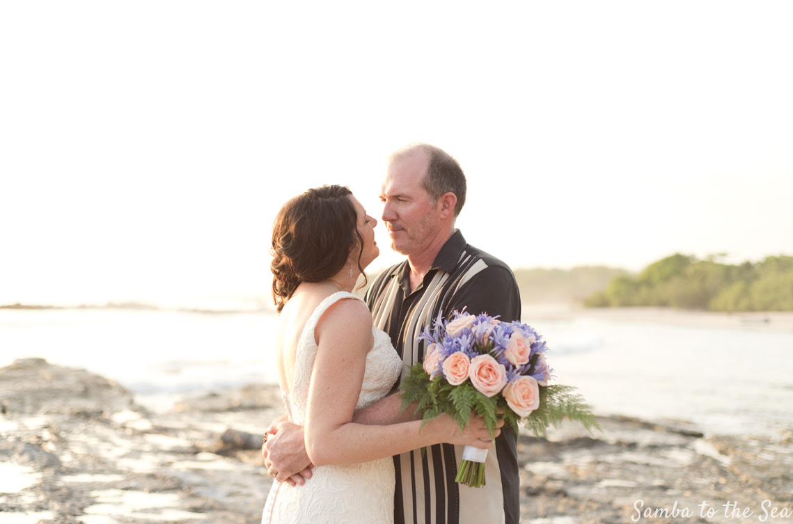 Bride and groom on the beach after wedding in Nosara, Costa Rica. Photographed by Kristen M. Brown, Samba to the Sea Photography.
