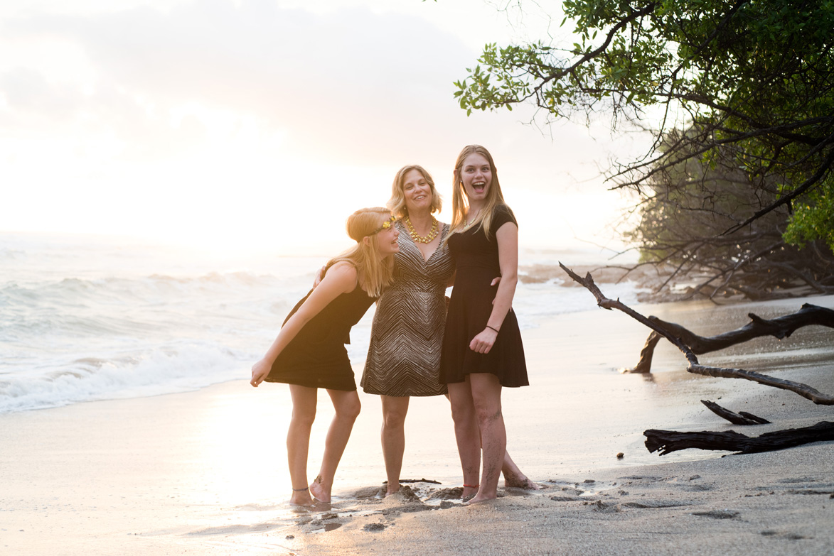 Family laughing at sunset in Costa Rica. Photographed by Kristen M. Brown, Samba to the Sea Photography.