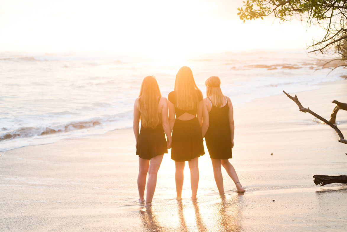 Cousins watching sunset during family photos in Costa Rica. Photographed by Kristen M. Brown, Samba to the Sea Photography.