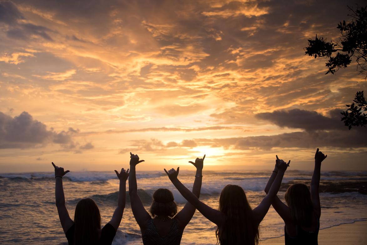 Shaka sign during sunset in Costa Rica. Photographed by Kristen M. Brown, Samba to the Sea Photography.