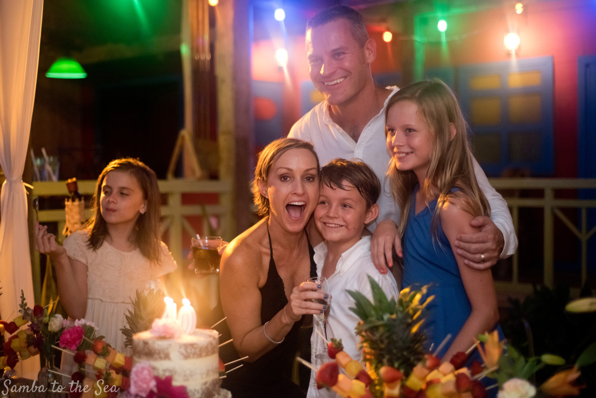 Birthday girl with her family at Father Rooster in Costa Rica. Photographed by Kristen M. Brown, Samba to the Sea Photography.