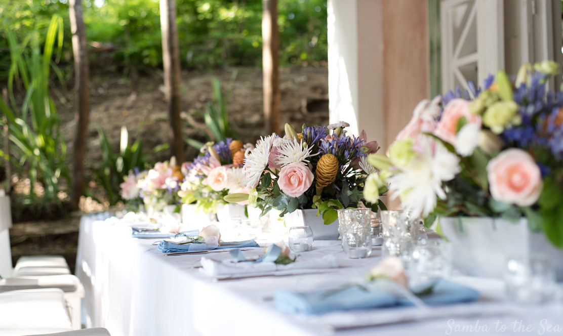 Beautiful flowers on table for wedding at La Luna Restaurant in Playa Pelada, Nosara, Costa Rica. Wedding design by Weddings Nosara, Photographed by Kristen M. Brown, Samba to the Sea Photography.