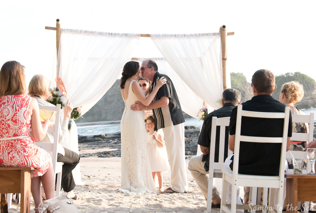 First kiss during wedding in Nosara, Costa Rica. Photographed by Kristen M. Brown, Samba to the Sea Photography.