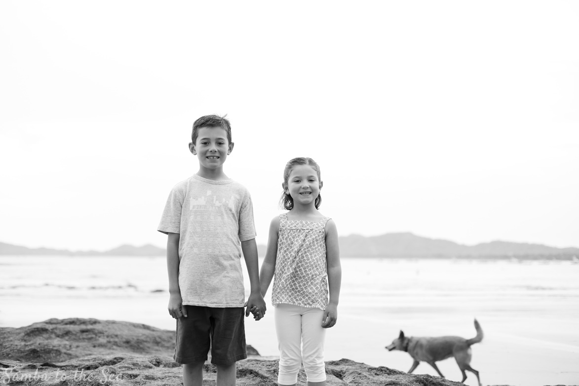 Siblings holding hands during family portraits in Costa Rica. Photographed by Kristen M. Brown, Samba to the Sea Photography.