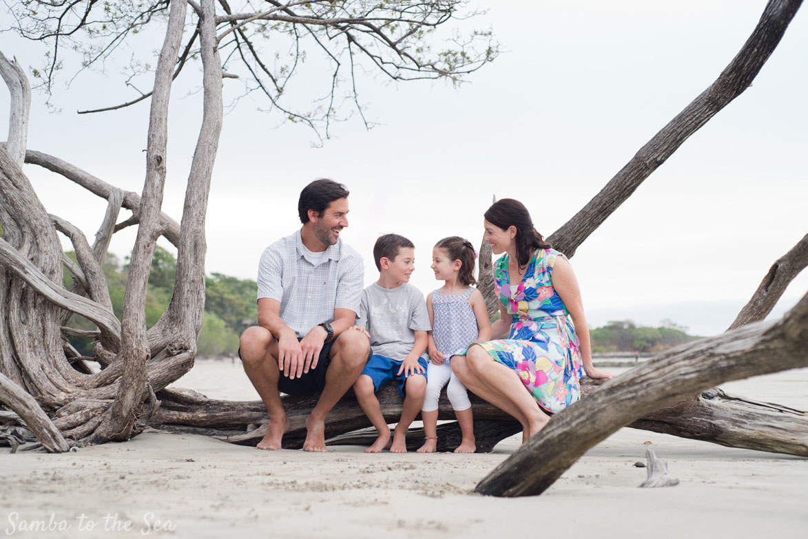 Family laughing during family portraits in Costa Rica. Photographed by Kristen M. Brown, Samba to the Sea Photography.
