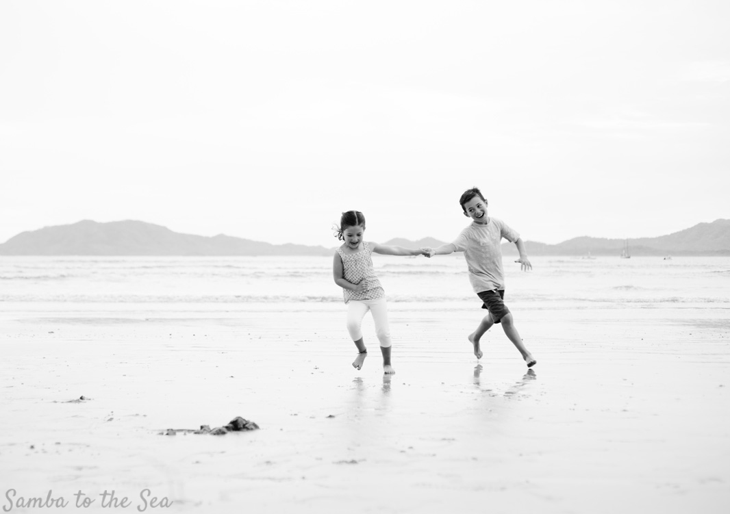 Brother and sister playing on the beach in Costa Rica. Photographed by Kristen M. Brown, Samba to the Sea Photography.
