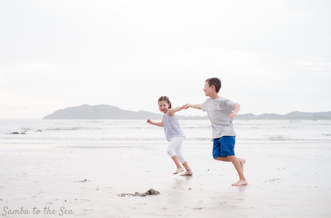 Siblings playing on the beach in Tamarindo, Costa Rica. Photographed by Kristen M. Brown, Samba to the Sea Photography.
