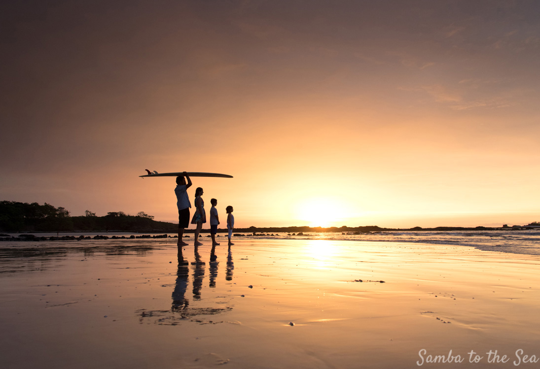 Family portrait silhouette on the beach in Tamarindo, Costa Rica. Photographed by Kristen M. Brown, Samba to the Sea Photography.