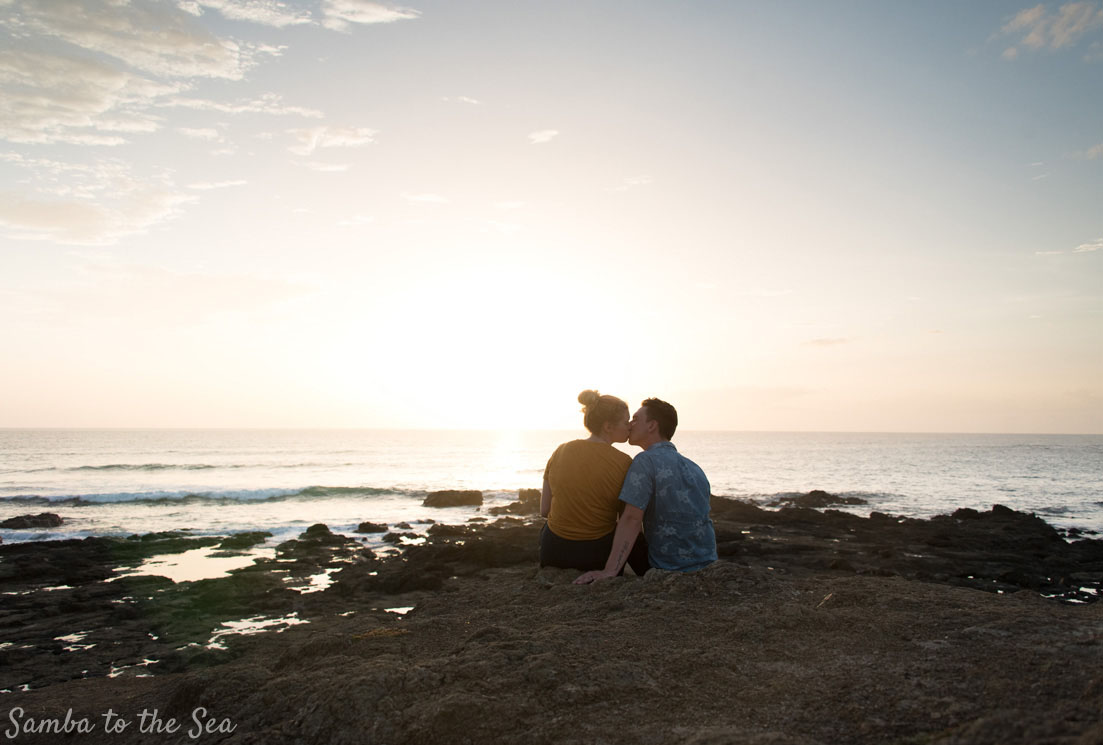 Couple watching sunset on the point in Tamarindo, Costa Rica. Photographed by Kristen M. Brown, Samba to the Sea Photography.