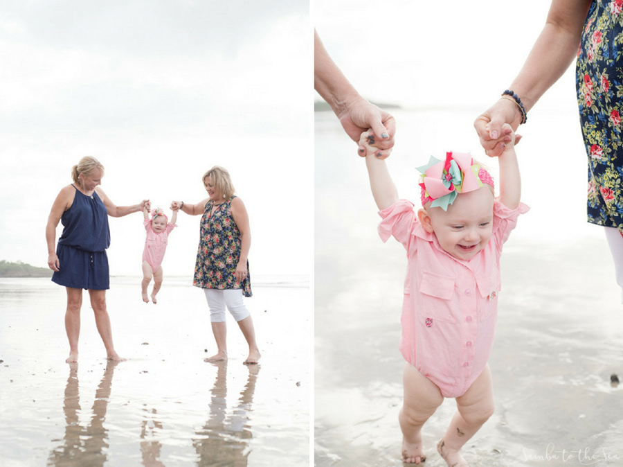 Grandmas holding their granddaughter's hand on the beach in Costa Rica. Photographed by Kristen M. Brown, Samba to the Sea Photography.