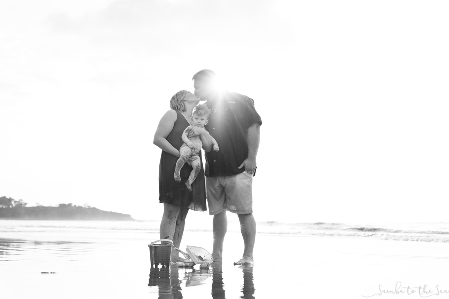 Black and white family portrait in Tamarindo, Costa Rica. Photographed by Kristen M. Brown, Samba to the Sea Photography.